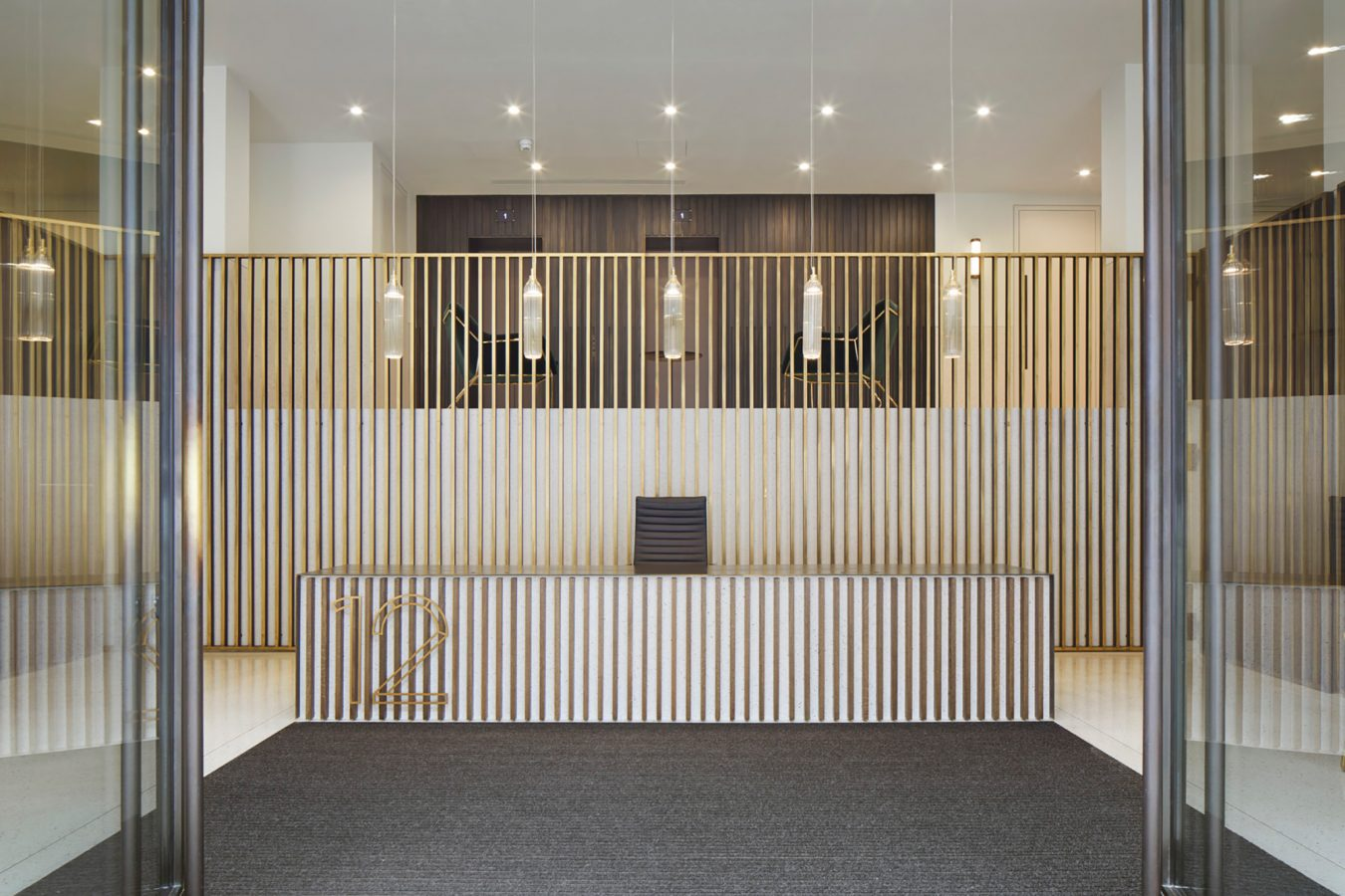 Gough Square reception refurbishment with fine joinery works and industrial style lightning created in collaboration with DMFK Architects.
