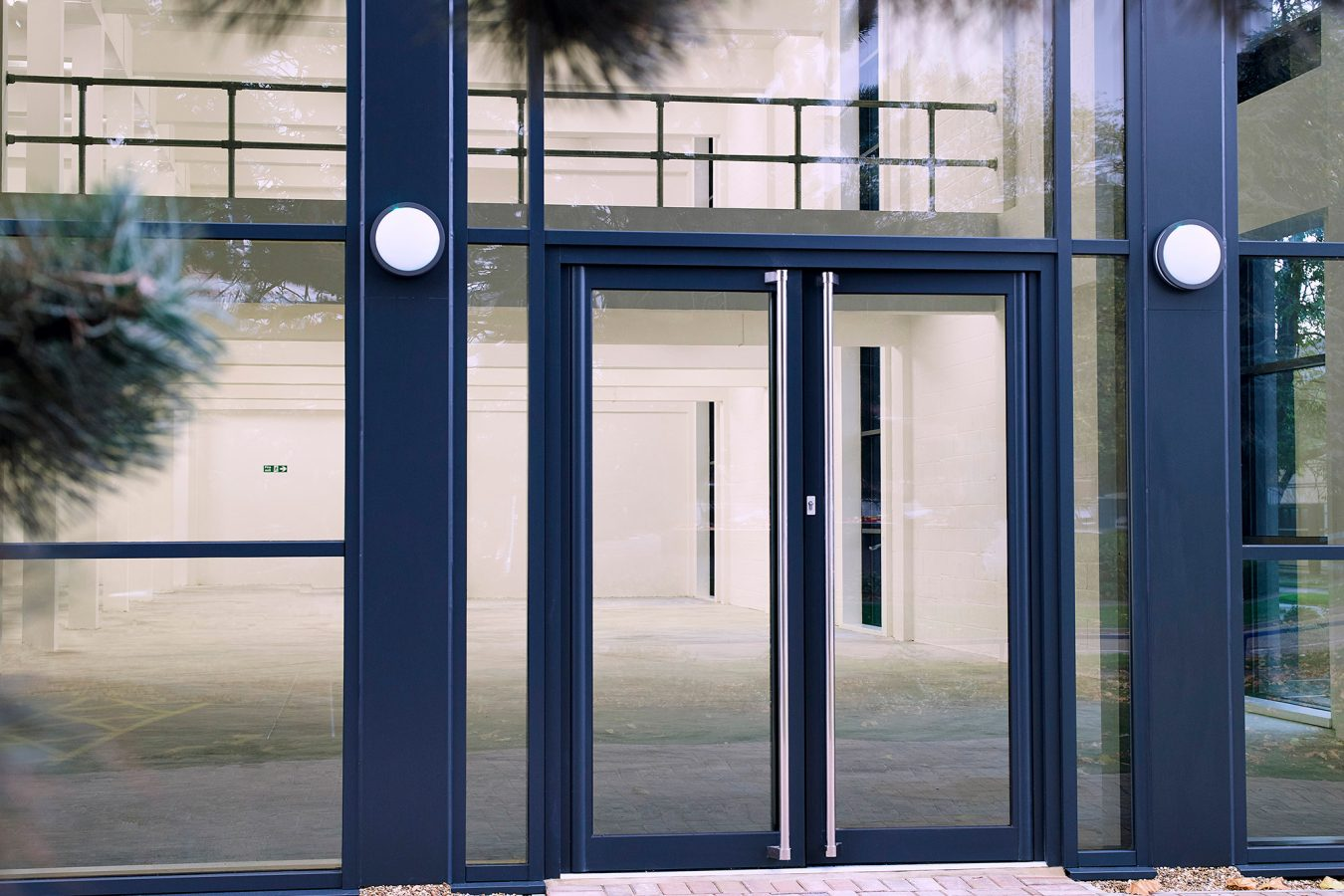 Refurbished metal doors and cladding for industrial units near London.
