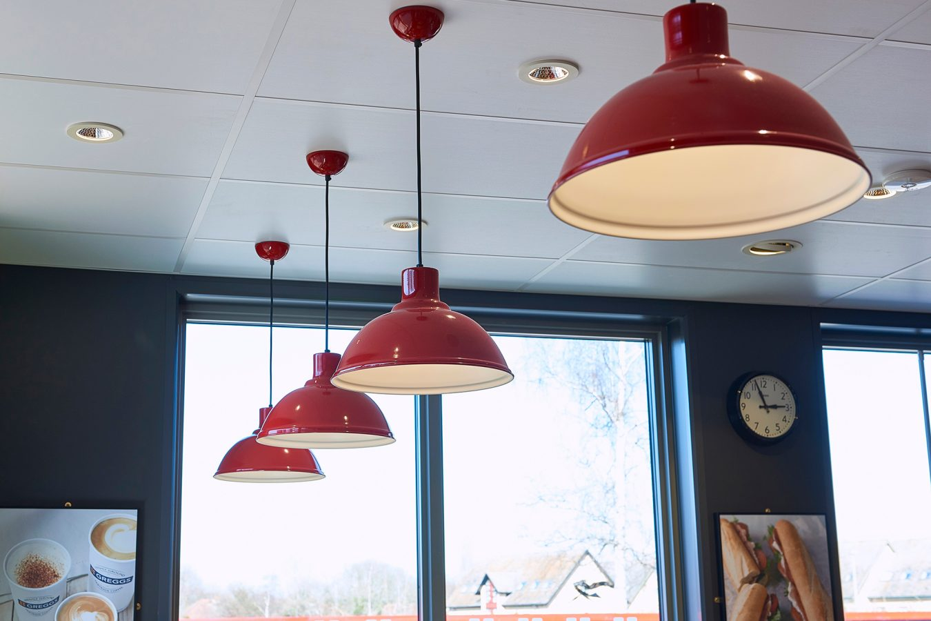 Greggs pop-up unit refurbished in Bracknell, with a modern interior lightining design, in red.