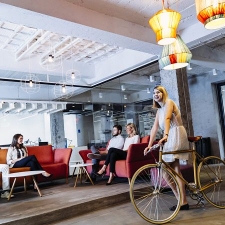 Modern office layout, employee well being, office design, women on a retro bicycle , near London.
