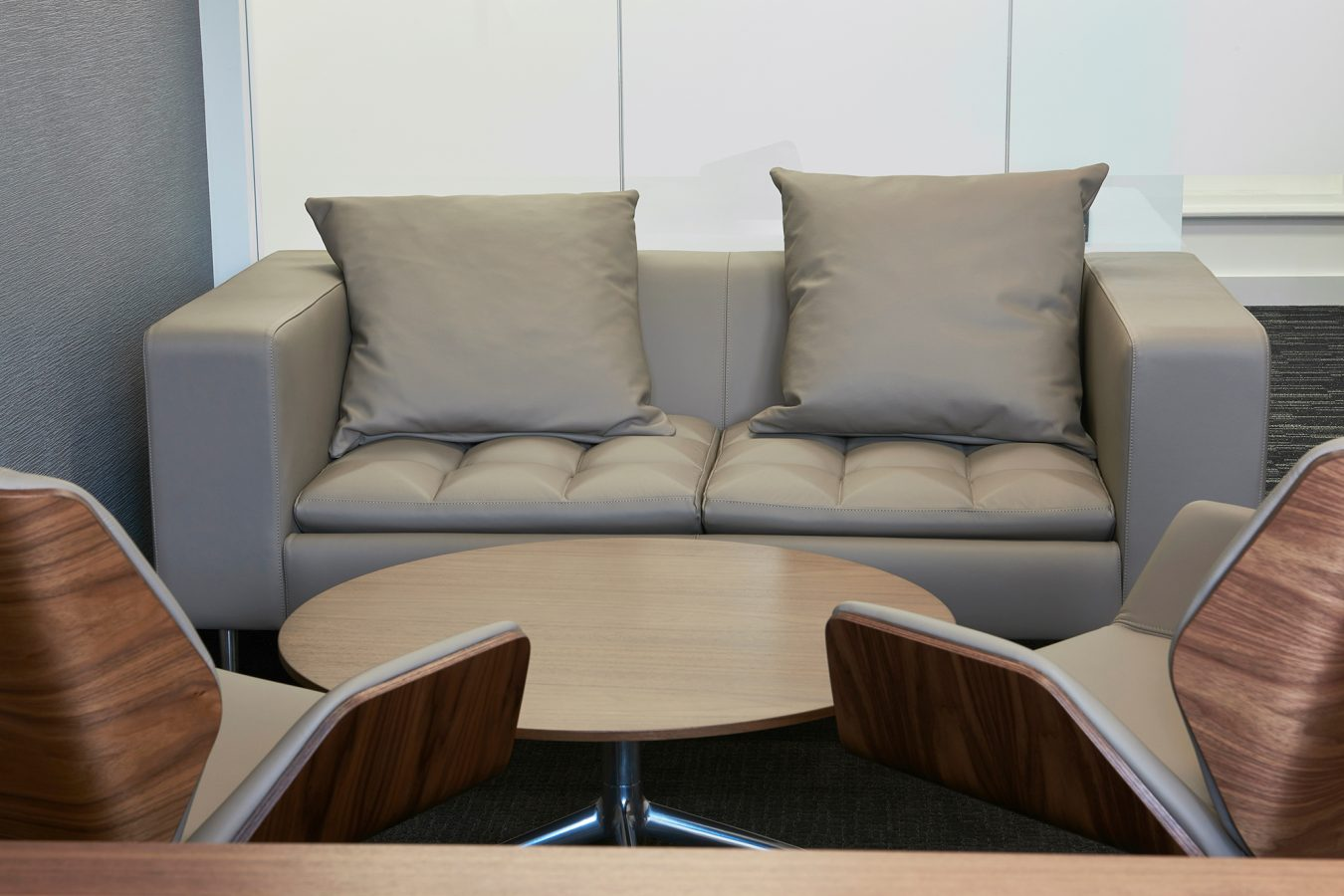 Leather couch and pillows for office design in nude colour, near London.