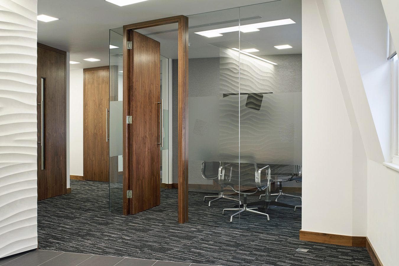 Glass partitions for office fit out, industrial design and modern carpet, office furniture, near London.