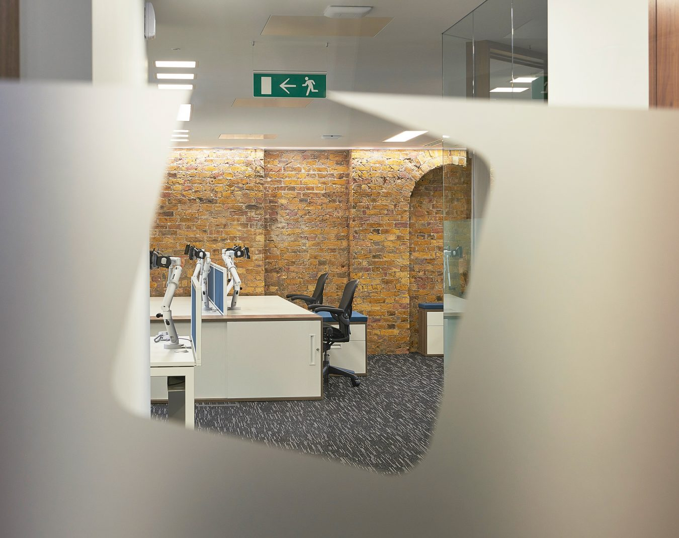 Workspace design and fit out, exposed brickwork, white office desks, LED lights, modern look, near London.