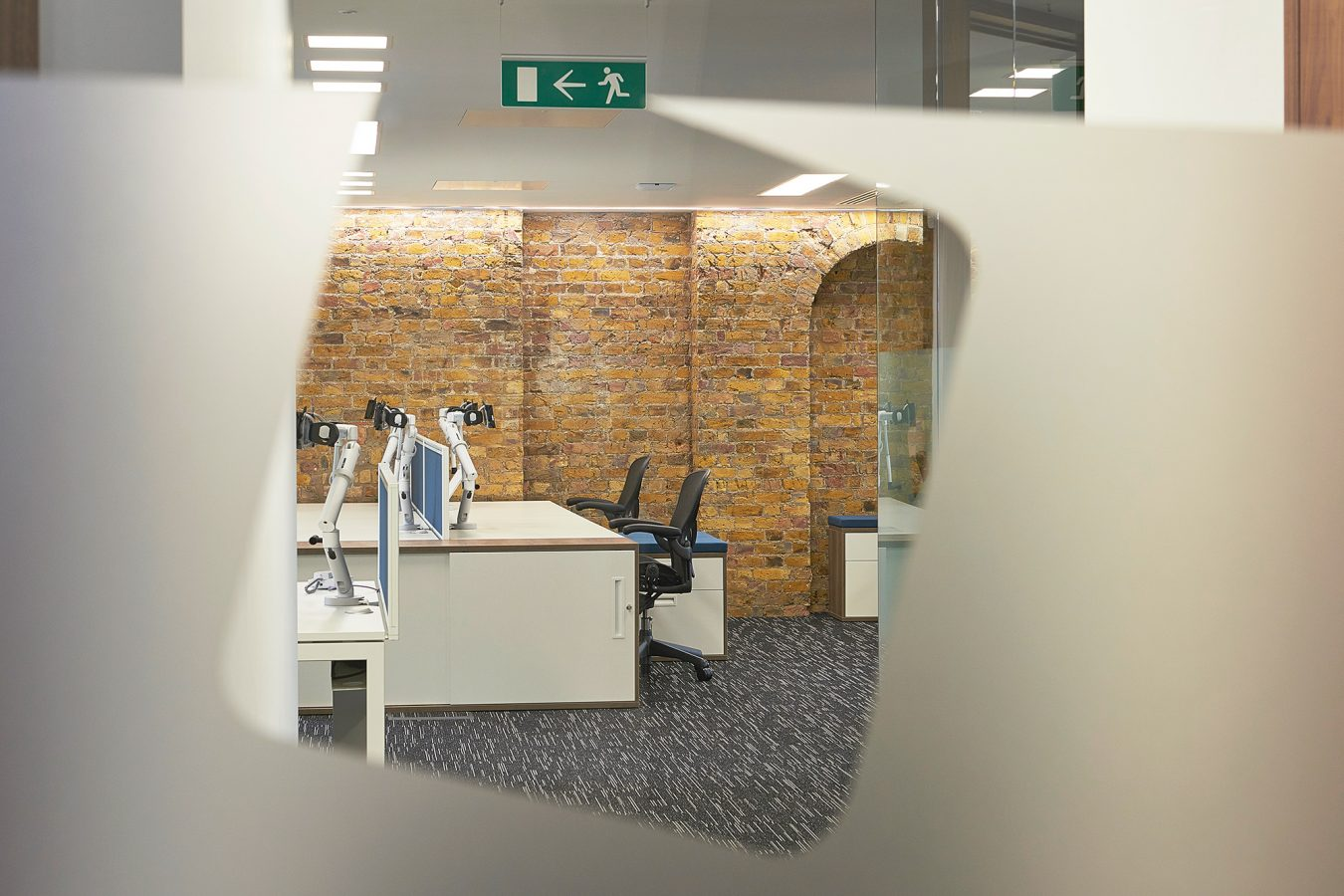 Workplace interior design and fit out, exposed brickwork, white office desks, LED lights, modern look, near London.