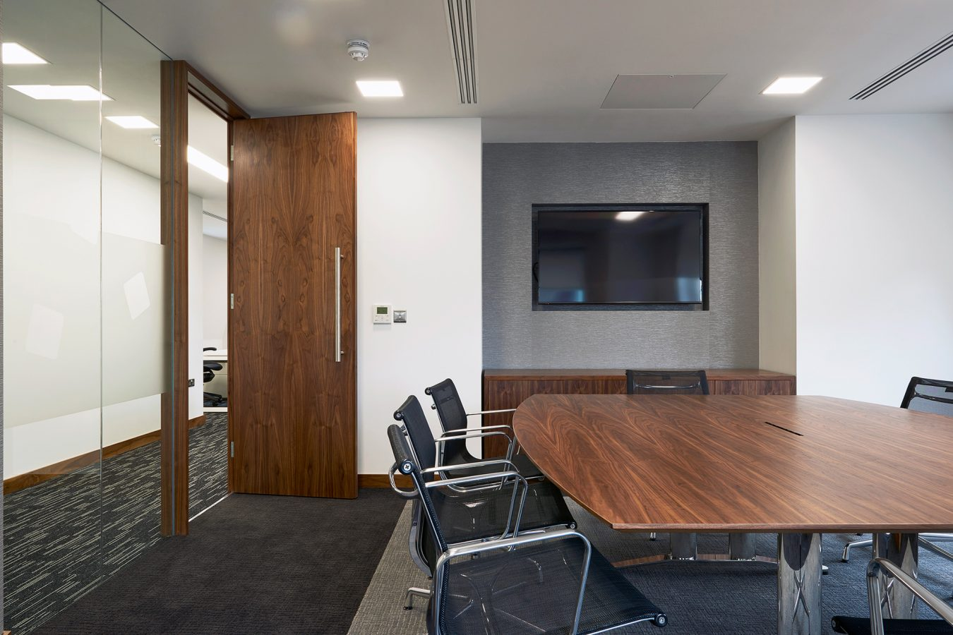 Meeting room fit out, refurbishment solutions for office, laminate wood furniture, near London.