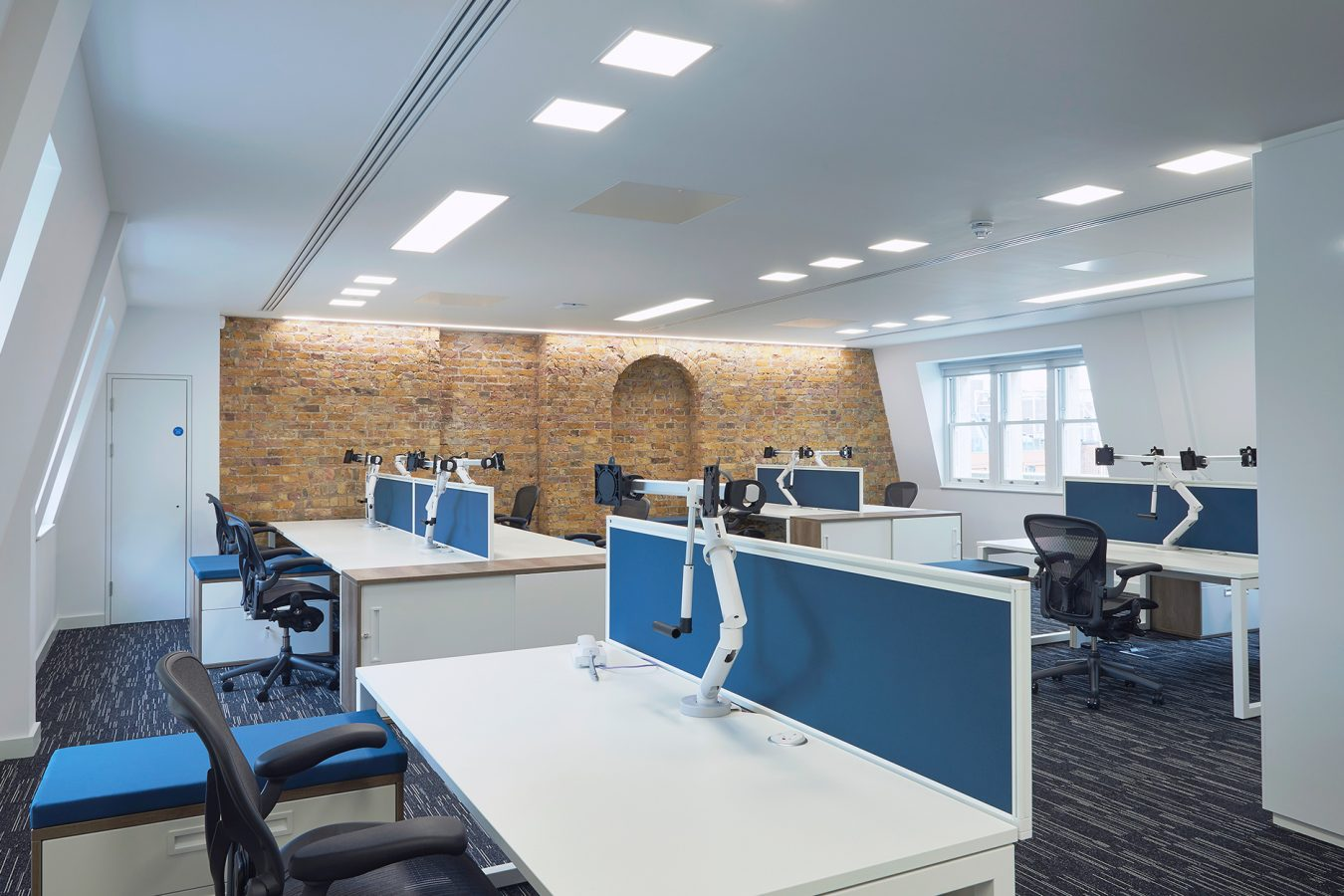Modern open plan office design project decorated with exposed brickwork, LED lighting and dropped out ceiling, near Bank.