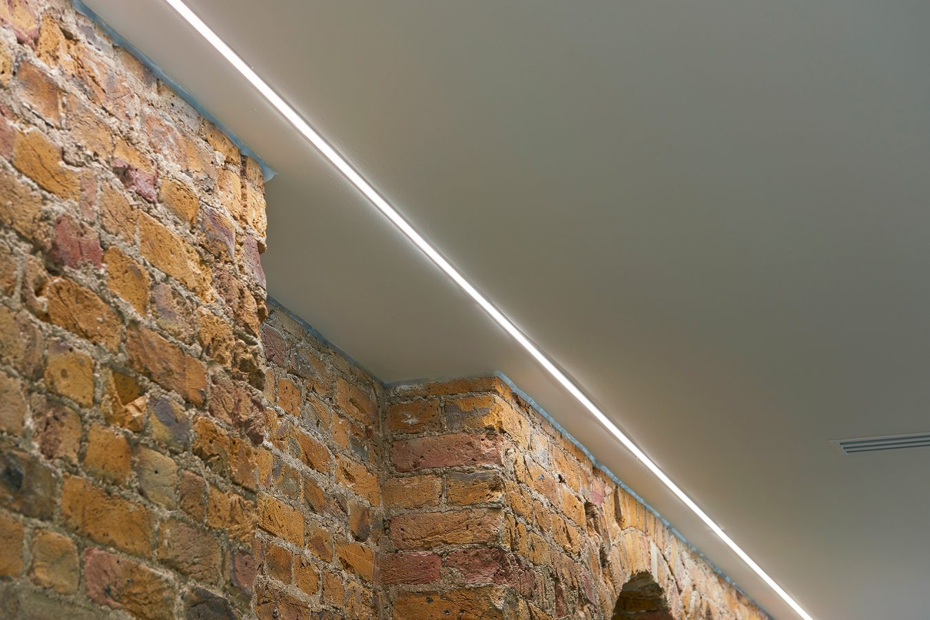 Exposed brickwork, office refurbishment for modern work space and LED lights added to enhance luminosity, near London.,