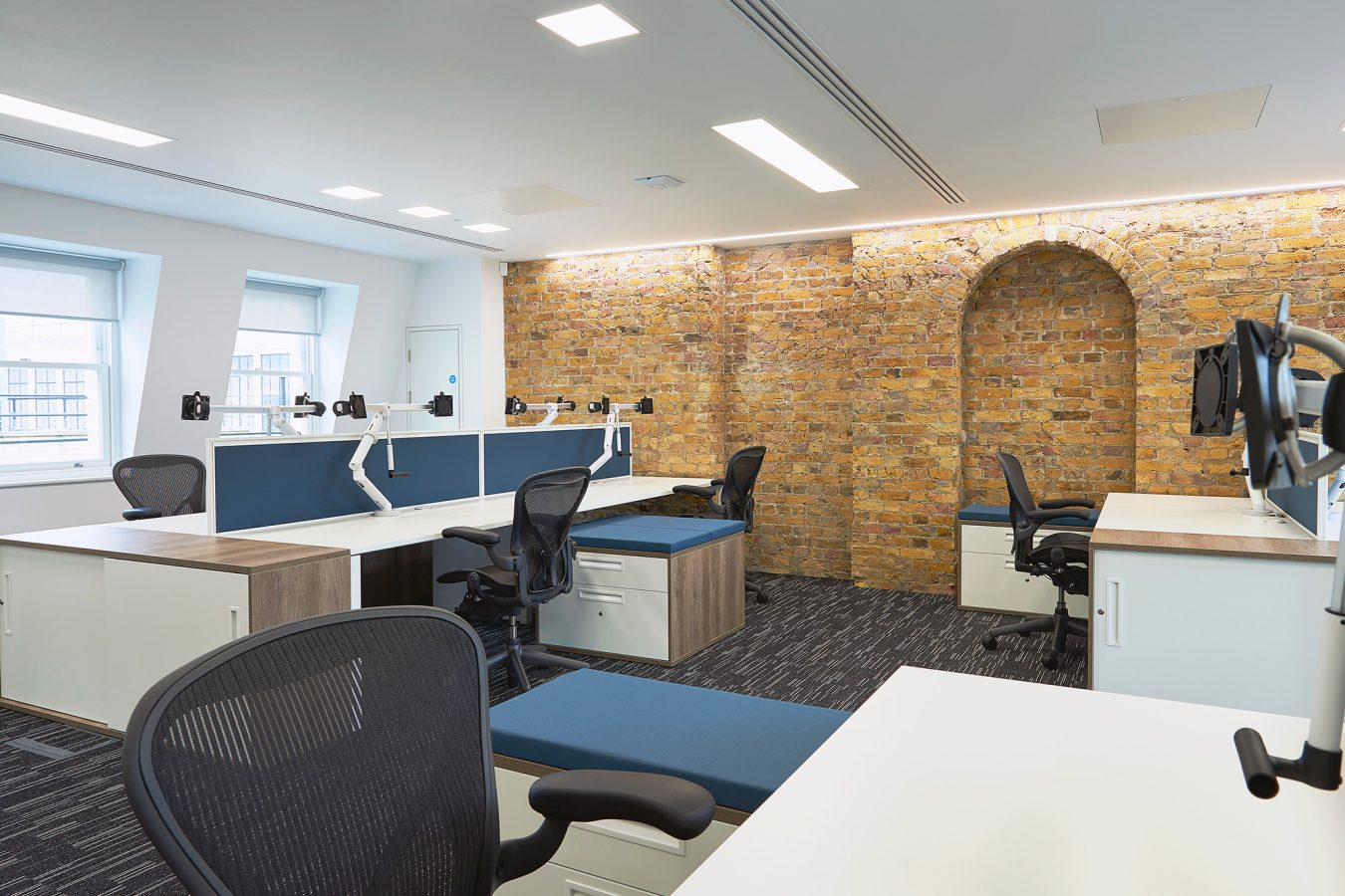 Modern office furniture ideas, exposed brickwork, industrial style design.