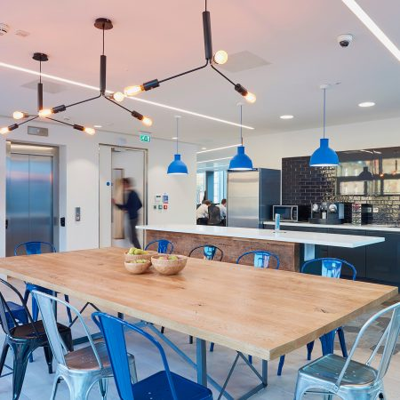 Industrial style blue fitted kitchen for office near London.