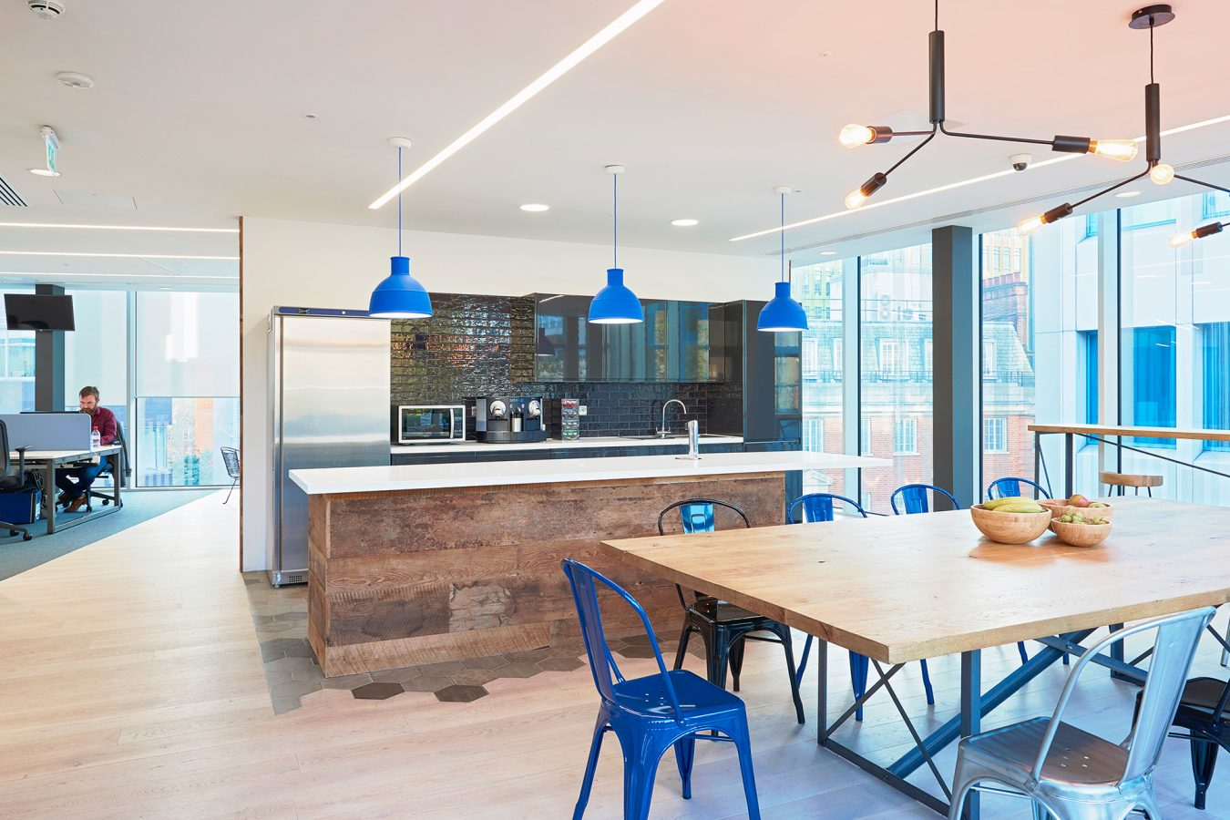Kitchen fit out in blue, industrial style kitchen, modern design, pendant lights.