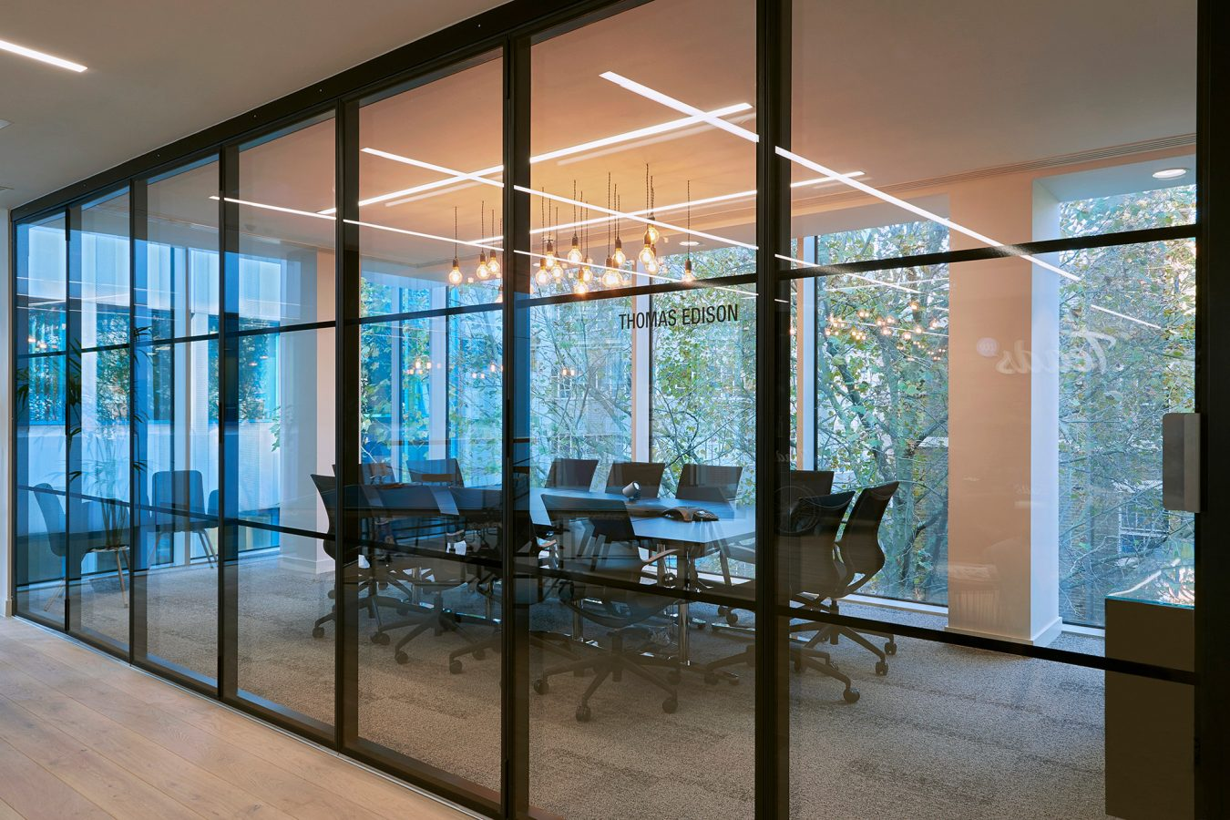 Modern meeting room design, pendant lights, glass partitions, office design, contemporary style, office fit out near London.