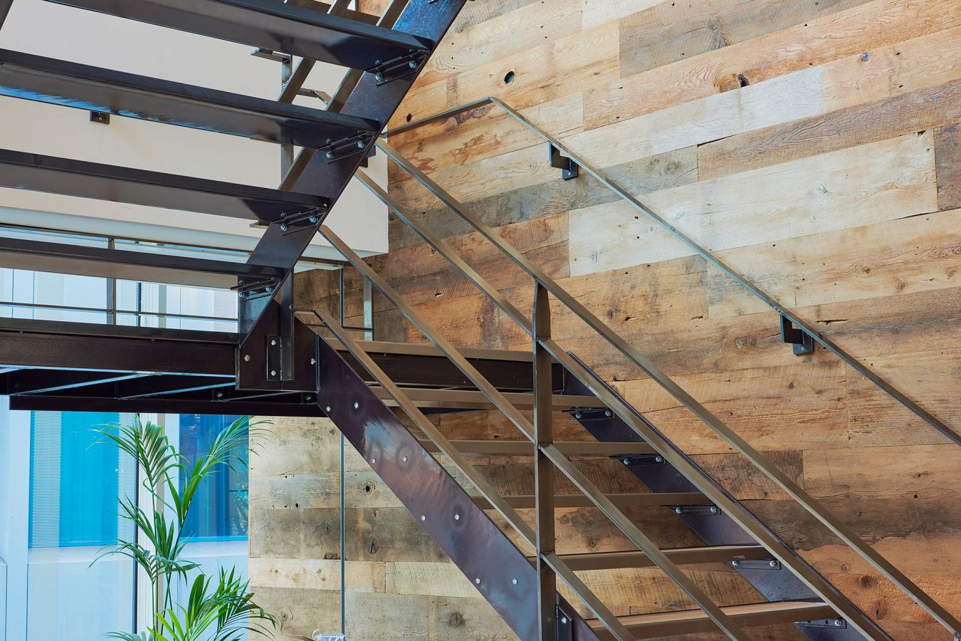 Timber staircase design, craftsmanship, metal handle, industrial office design, fit out, refurbishment near London.