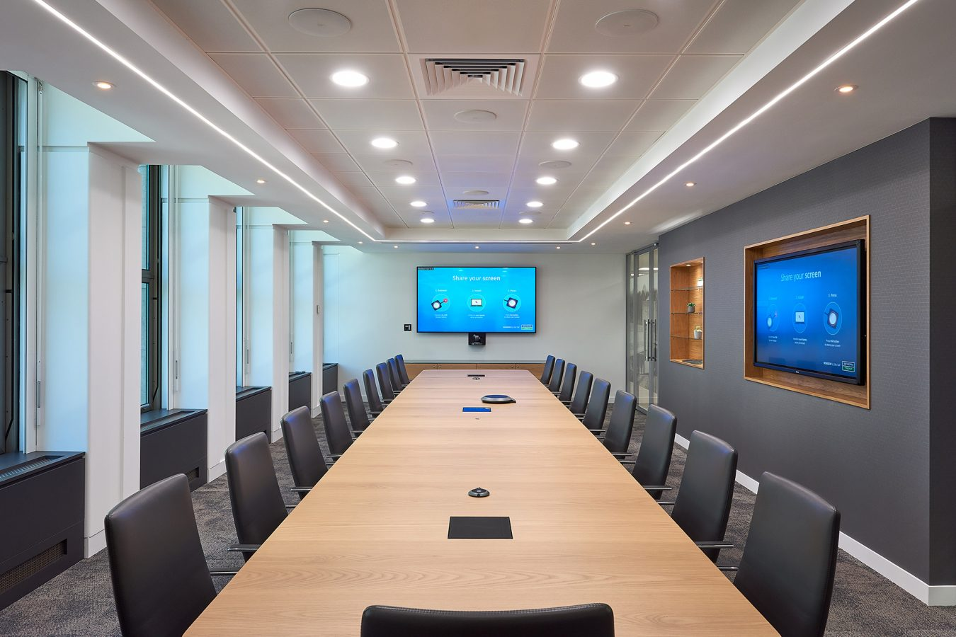 A meeting room for office relocation with modern technology and functional furniture is increasing productivity and enriching company culture.