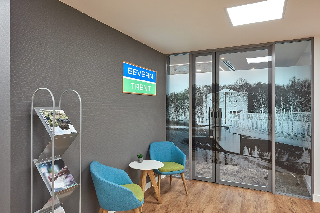 Modern waiting area in office and glass partitioned doors office near London