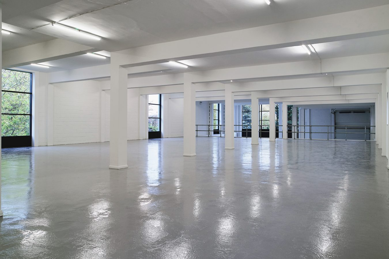 Inside of a refurbished warehouse, decorated in white throughout.
