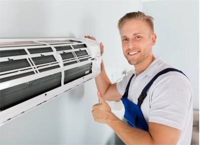 Worker installing air conditioner system in an office showing content about the good results.