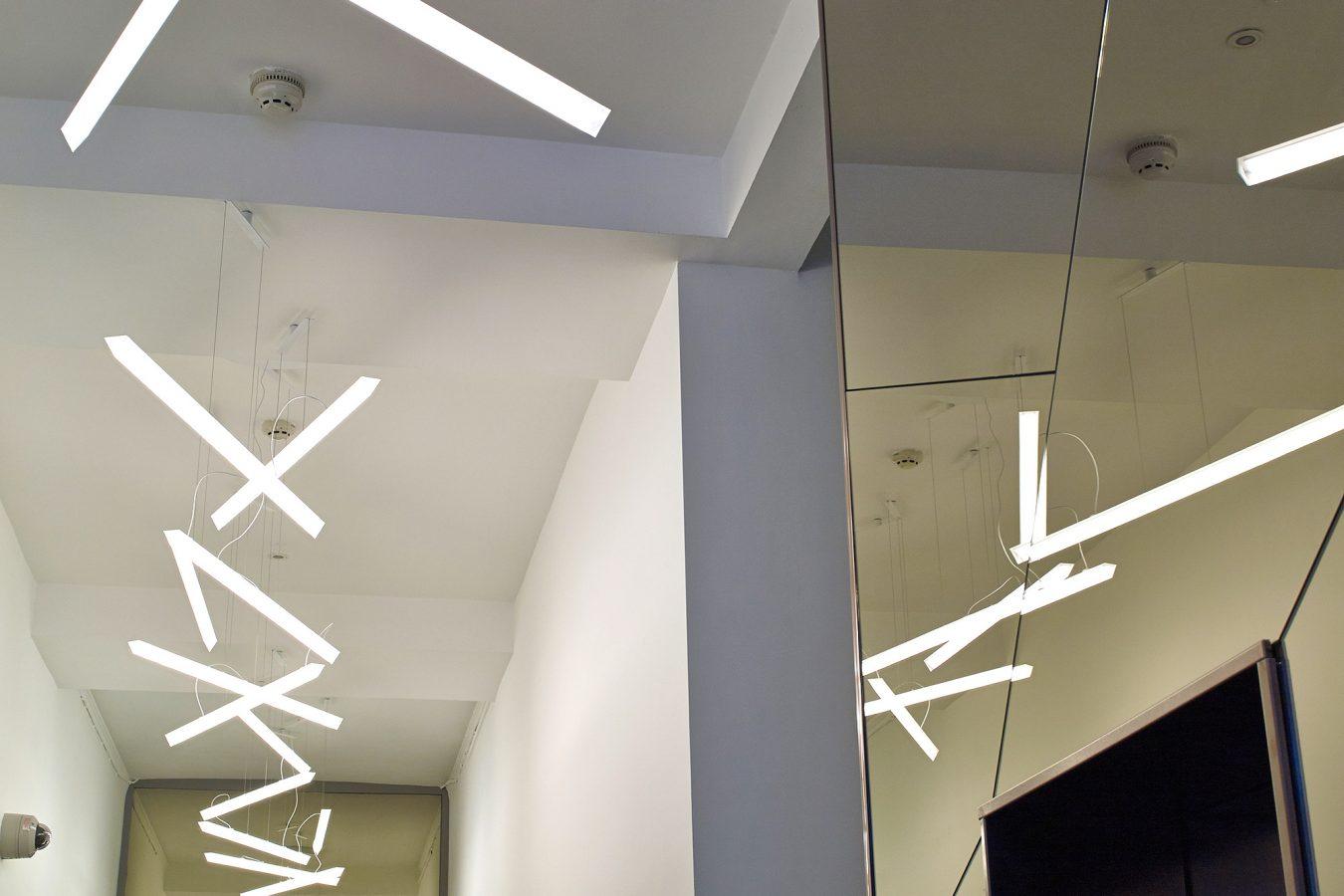 Pendant LED light on a hallway.