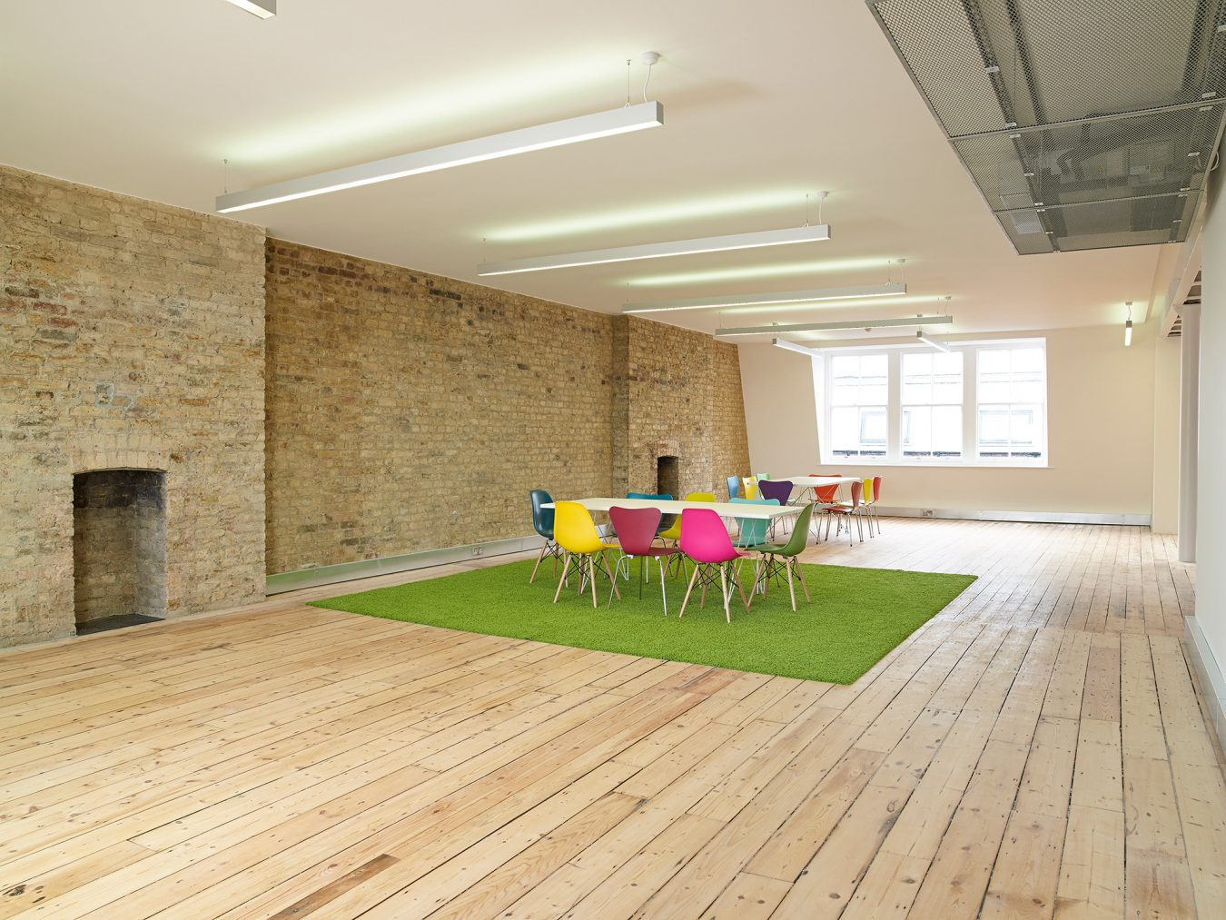 Feature brick wall and wood hard floor creted throug a Cat A office refurbishment in Hatton Garden