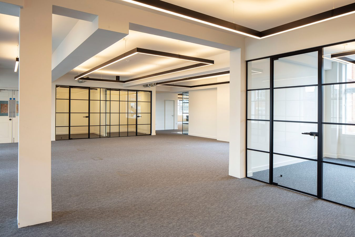 Refurbished space with crittal style glazede partitions and LED lights near Great Titchfield Street