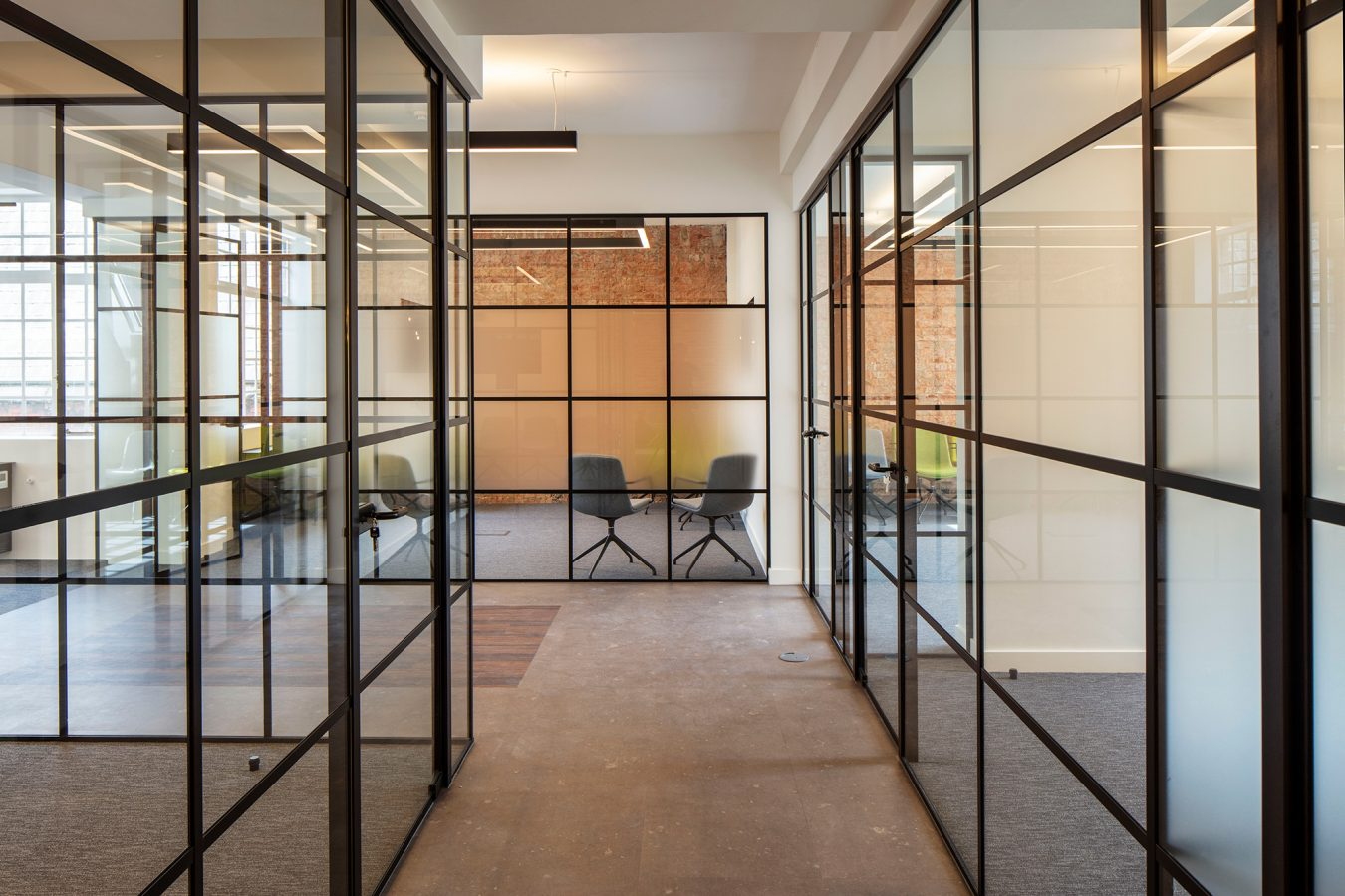 Partitions made of glazed window and doors in a office space