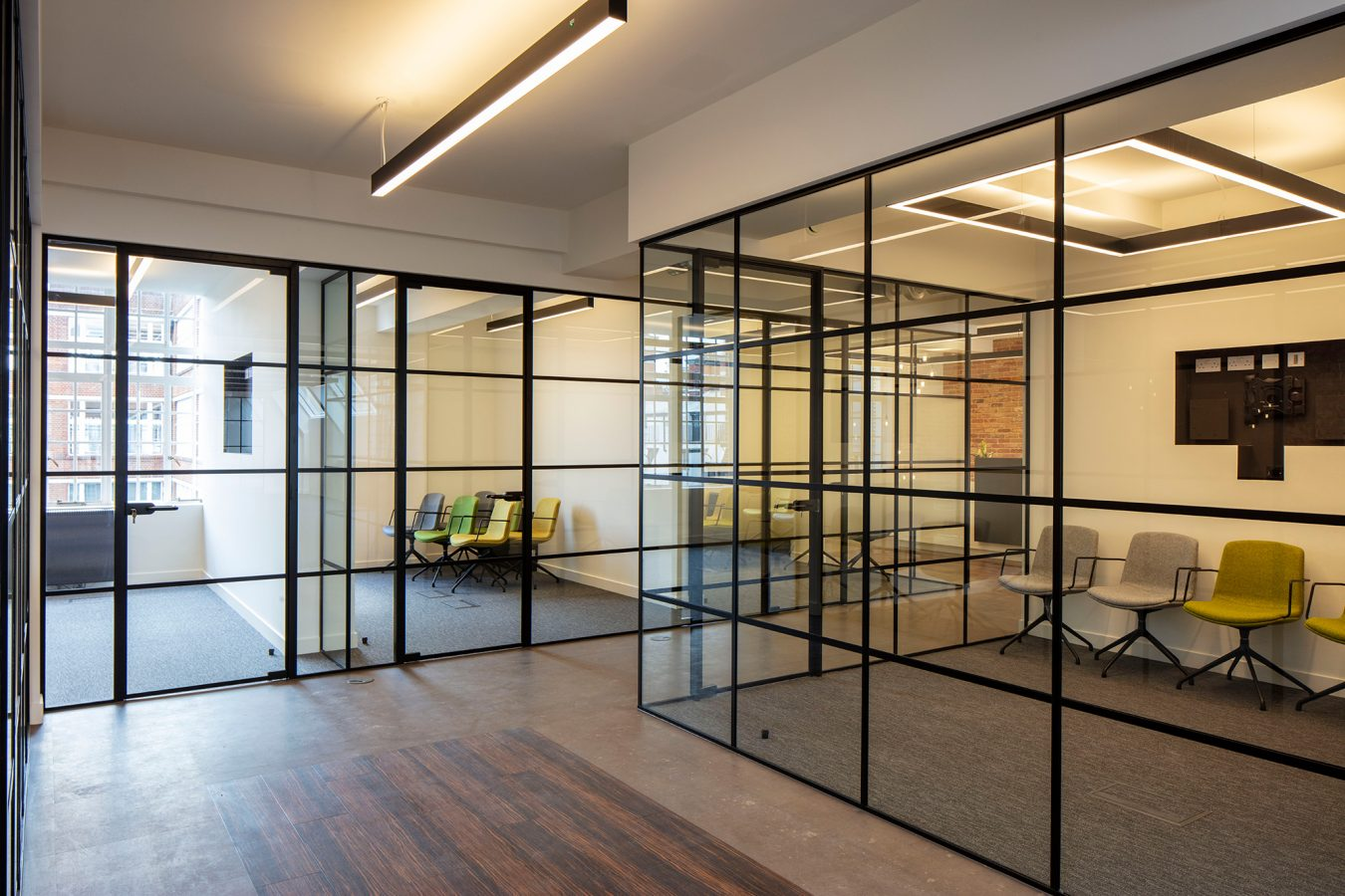 Critall style glazed partitions in a space near Great Titchfield Street refurbished for office relocation.