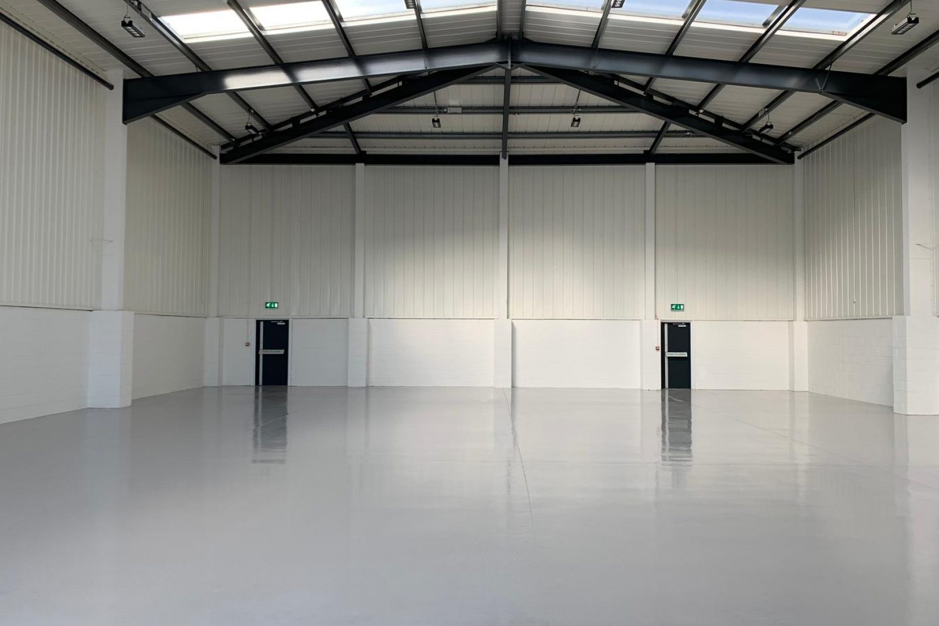 Warehouse space in Croydon, refurbished and sprayed in white color.