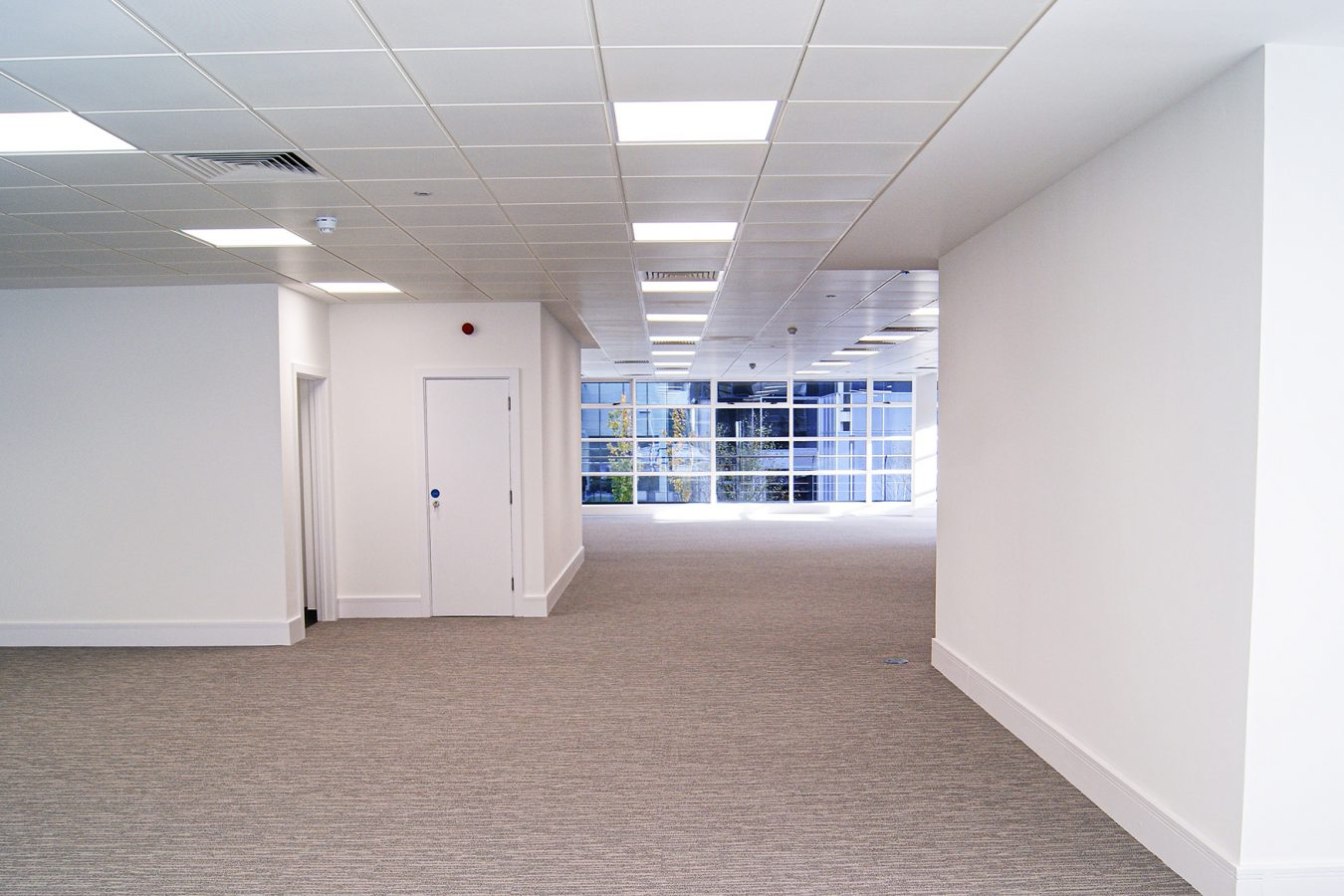 New carpet tiles throughout a refurbished office space in Harbour Excahnge.