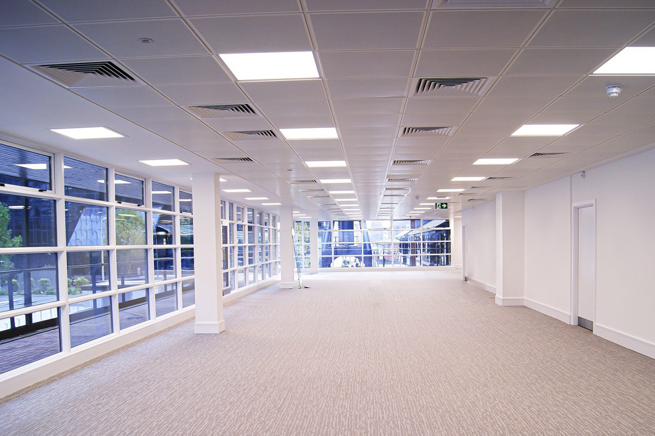 A white ceiling with LED lights for this open plan space in Harbour Exchange.