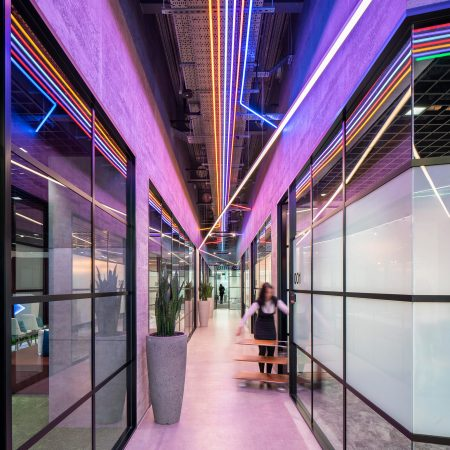 Industrial design fit-out for an office in London, glazed partitions and way finding LED lights create a sleek look and feel.