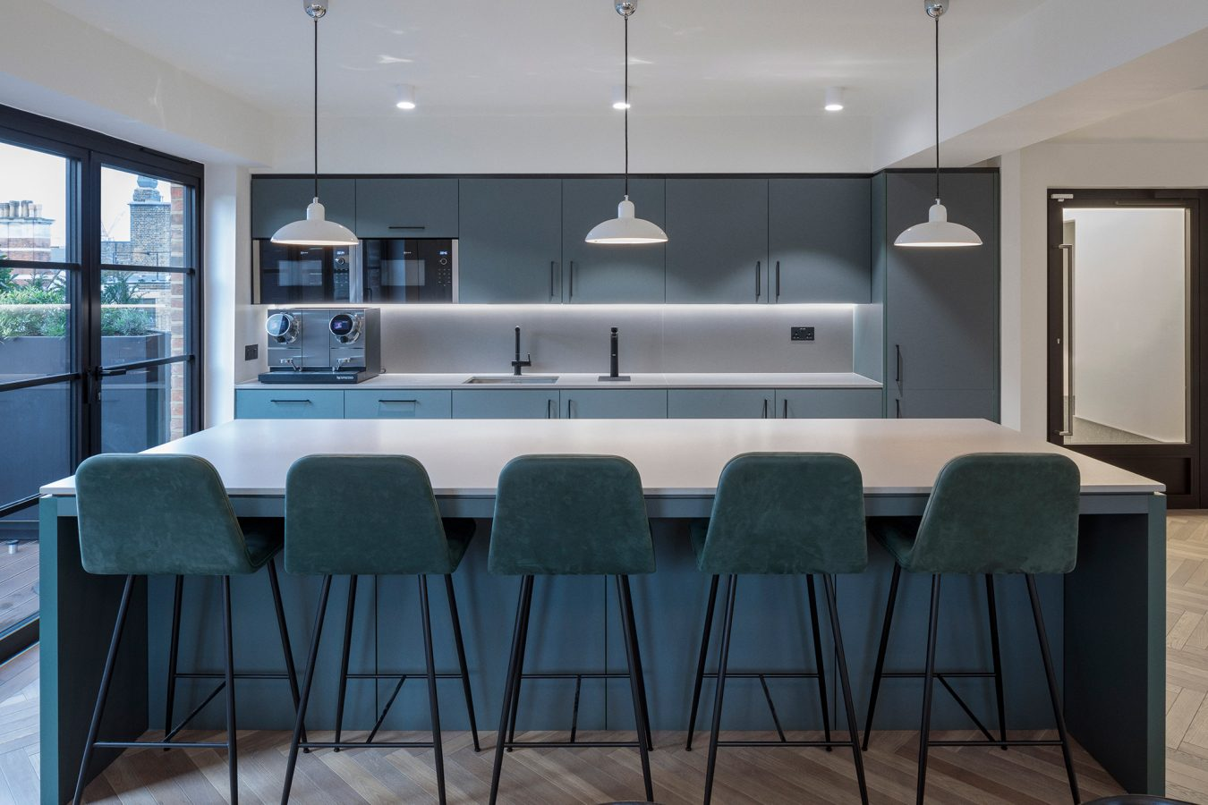 Modern kitchen and break-out area, created by Open team in Elsley House, Fitzrovia.