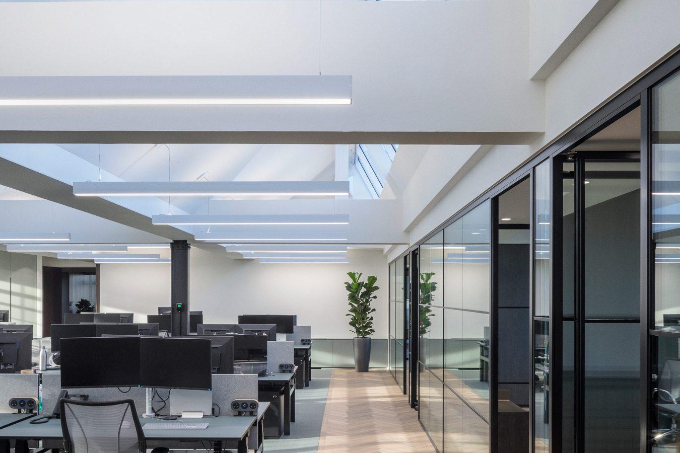 Herringbone parquet flooring in an open-plan workspace.
