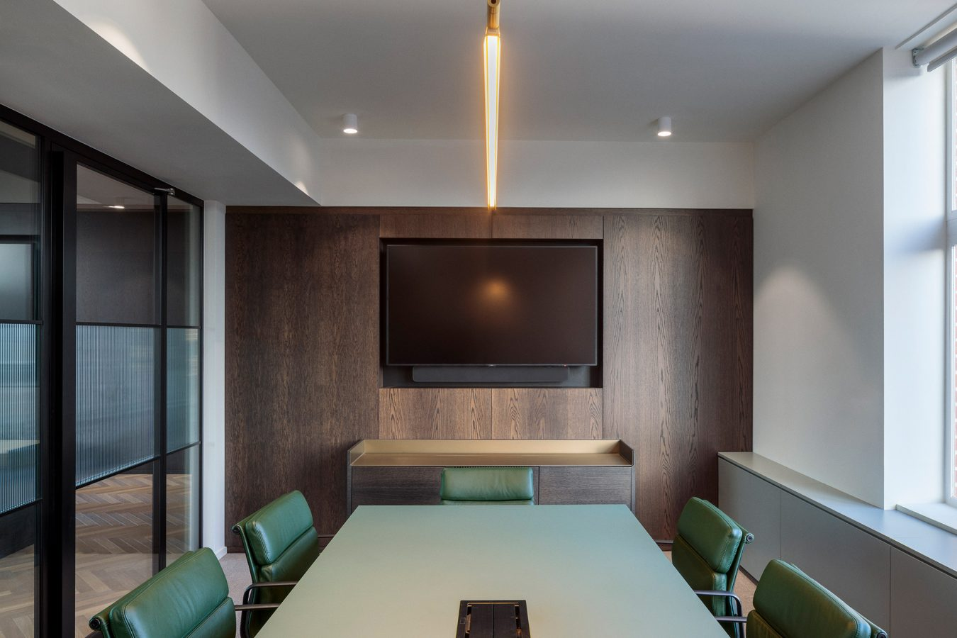Green meeting room table and green leather chairs to decorate an office room.