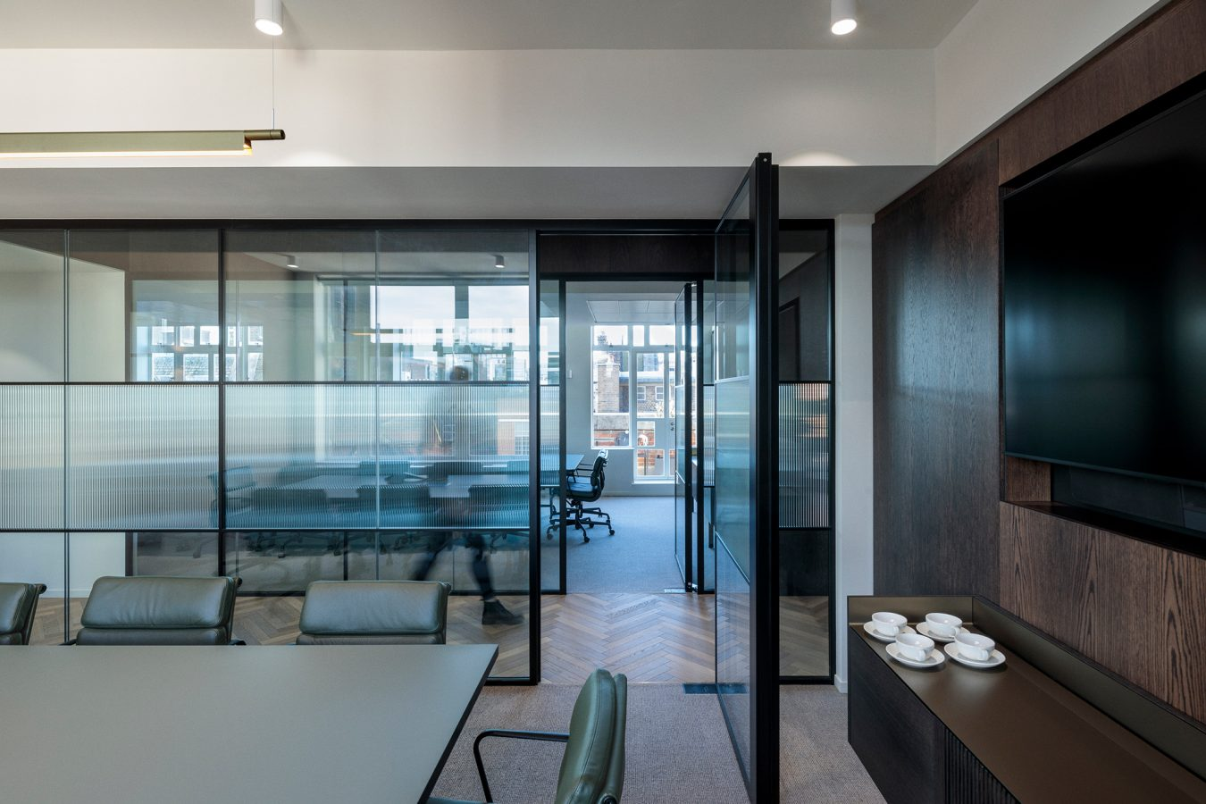 See through glass partitions in an office space.