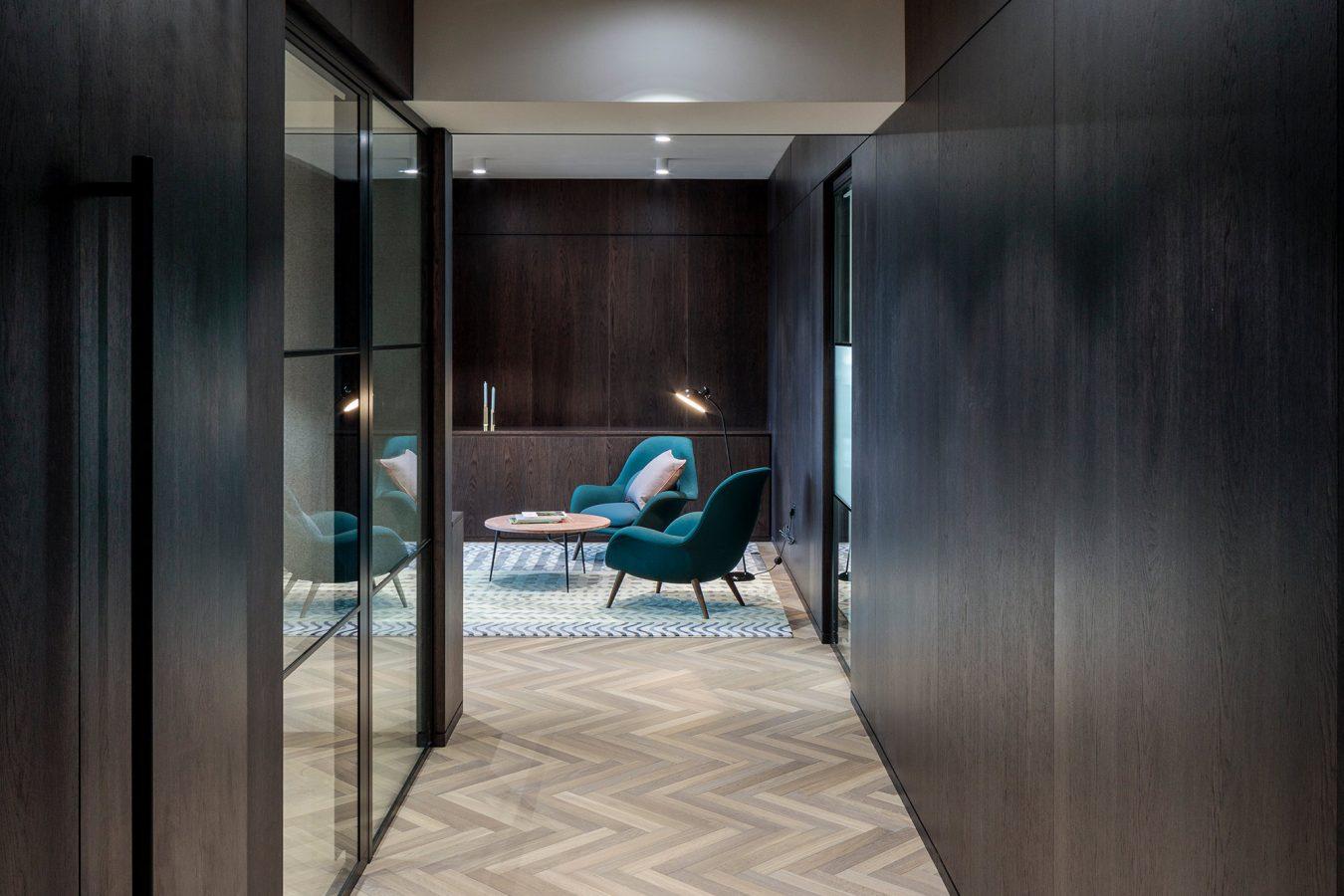Herringbone parquet floor tiles in an office, in London.