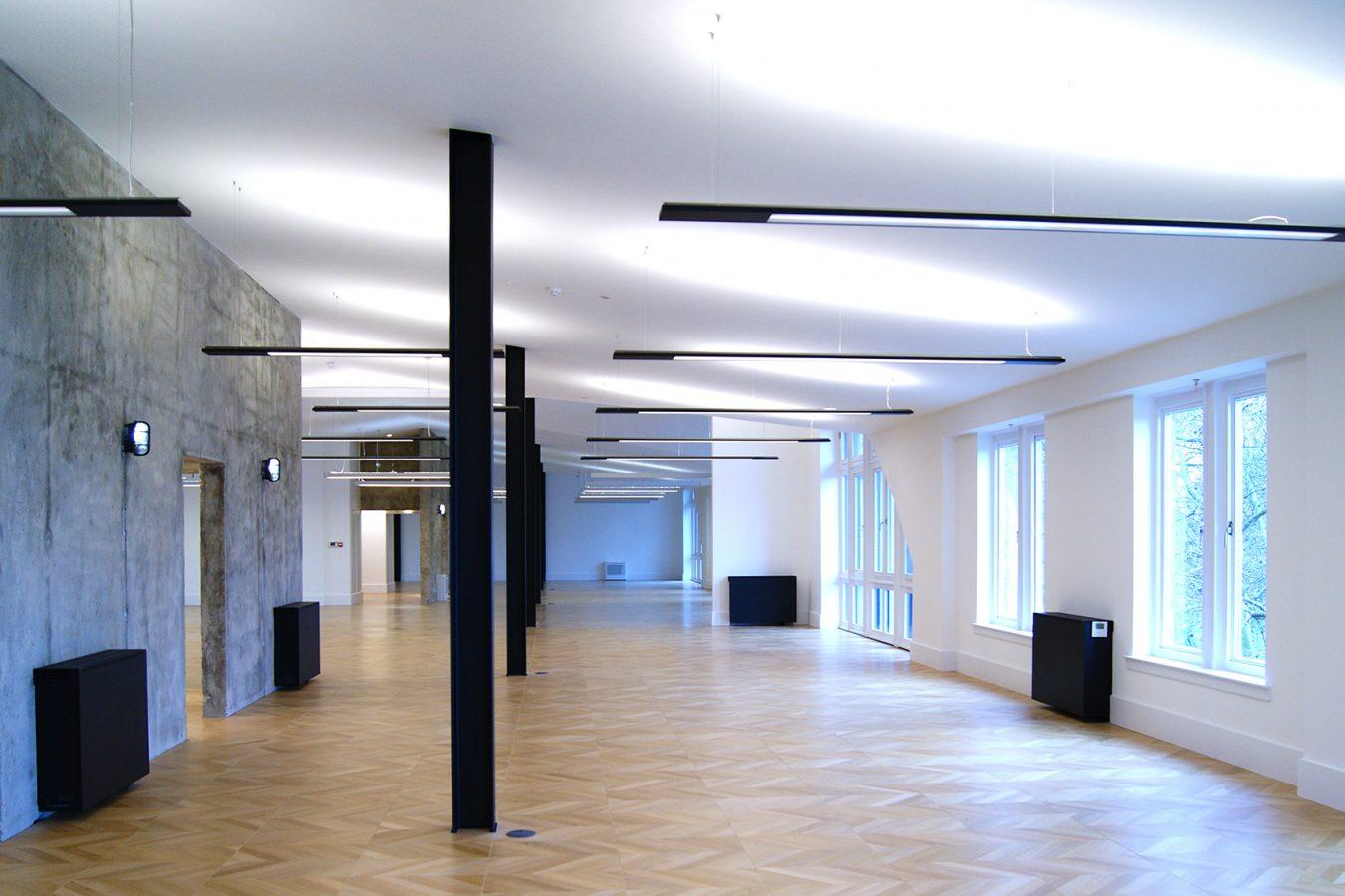 Exposed black steel beams create an industrial look in this office space in London.